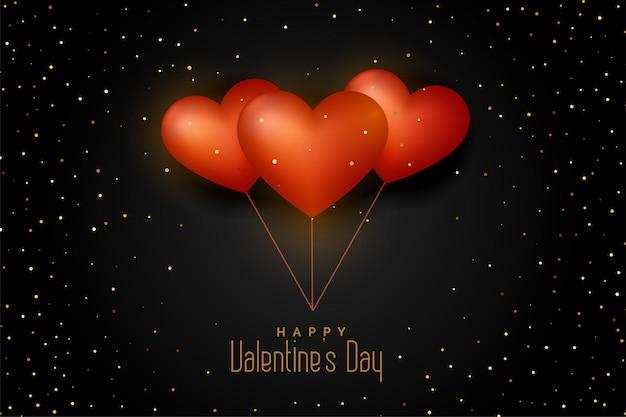 Coeurs de ballon sur fond noir avec des paillettes dorées