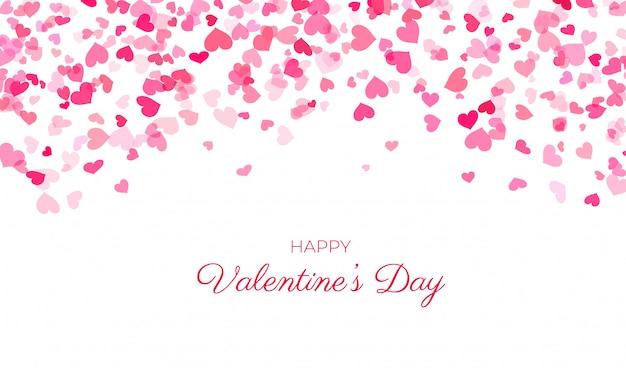 Coeurs de confettis roses sur blanc
