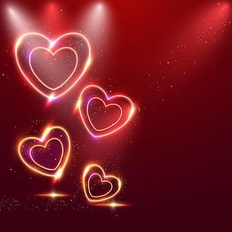 Coeurs d'effet néon avec des particules dorées sur fond rouge.
