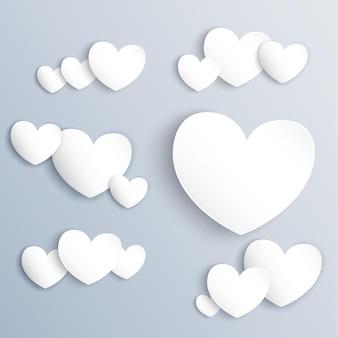 Coeurs de papier blanc sur fond gris avec des ombres douces