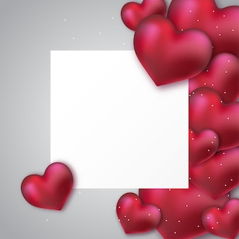 Coeurs rouges brillants avec du papier blanc