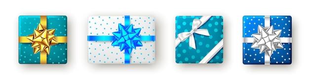 Coffret cadeau en argent doré bleu avec ruban et noeud vue de dessus fête de noël et nouvel an