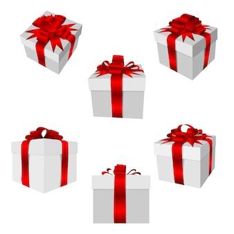 Coffret cadeau avec noeud rouge et ruban isolé.
