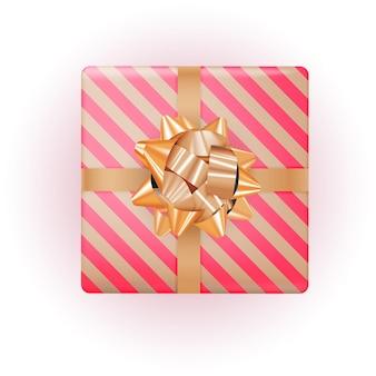 Coffret cadeau avec noeud et ruban d'or.