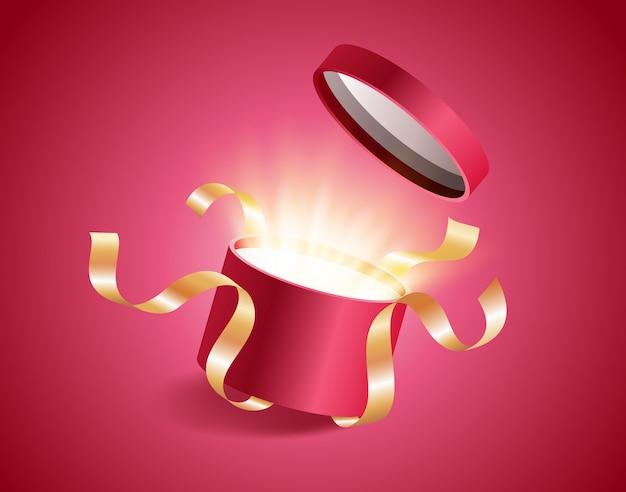 Coffret cadeau réaliste avec une lueur brillante magique et des rubans dorés