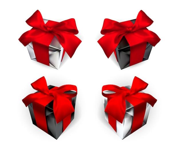 Coffret cadeau réaliste avec noeud rouge isolé sur fond gris