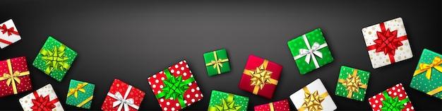 Coffret cadeau avec ruban et noeud vert rouge blanc et doré