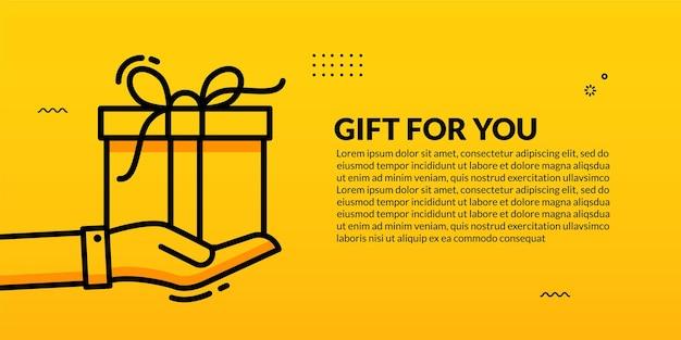 Coffret cadeau surprise poignée main sur jaune
