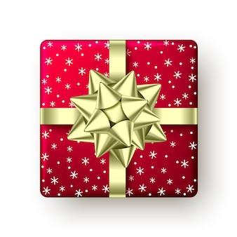 Coffret rouge avec ruban doré et noeud vue de dessus conception de paquet de fête de noël nouvel an