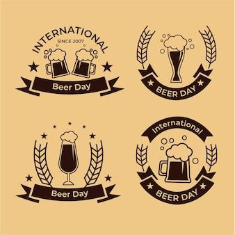 Collection de badges de la journée internationale de la bière au design plat