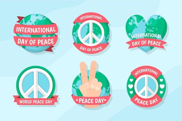 Collection de badges de la journée internationale de la paix design plat