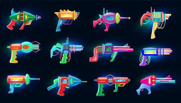 Collection de blasters colorés futuristes au néon qui brillent dans l'obscurité.