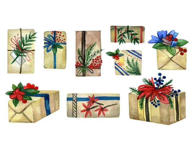 Collection de boîtes de noël dessinées à la main, emballées dans du papier et décorées de branches et de rubans...