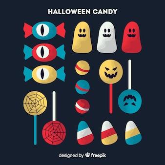 Collection de bonbons colorés d'halloween au design plat