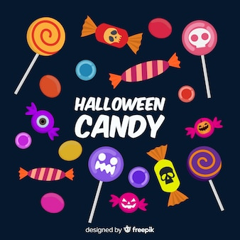 Collection de bonbons colorés d'halloween avec un design plat