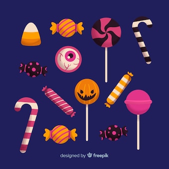 Collection de bonbons halloween dessinés à la main sur fond bleu