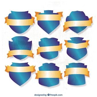 Collection de boucliers bleus avec des rubans d'or