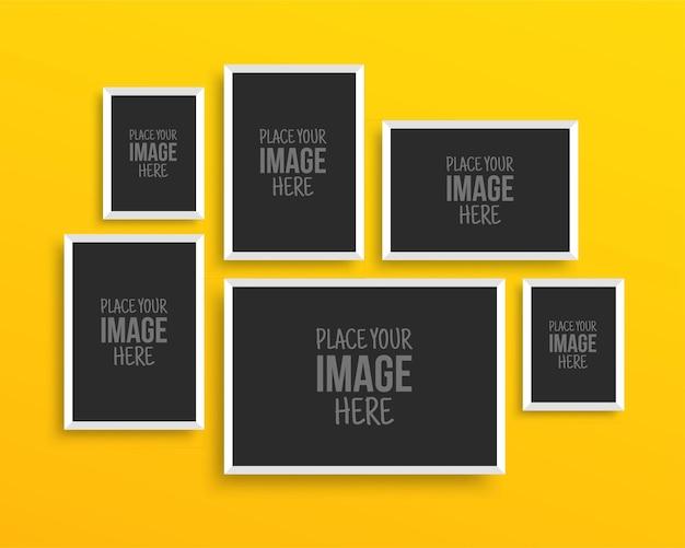 Collection de cadres photo sur mur jaune pour les impressions de conception, portefeuille de maquette de galerie vierge, isolé