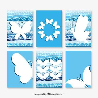 Collection de cartes bleues avec des papillons