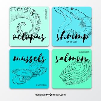 Collection de cartes de fruits de mer dessinés à la main