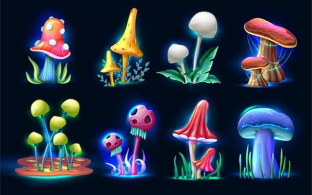 Collection de champignons magiques fantastiques de style dessin animé brillant dans le noir isolé