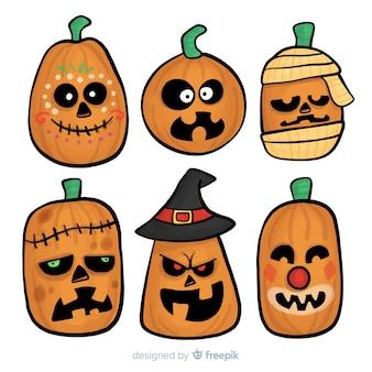 Collection de citrouilles d'halloween dessinées à la main drôle