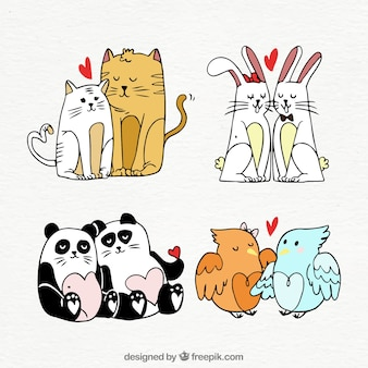 Collection de couple d'animaux de saint-valentin dessinés à la main