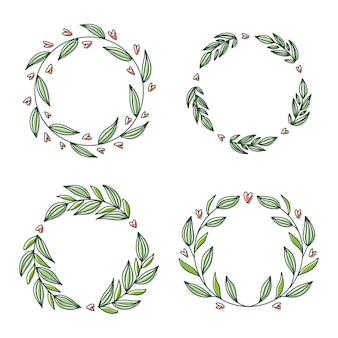 Collection de couronnes florales, dessinés à la main, isolé sur blanc. cadres ronds décoratifs