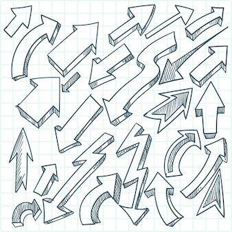 Collection de croquis de flèches de griffonnages dessinés à la main