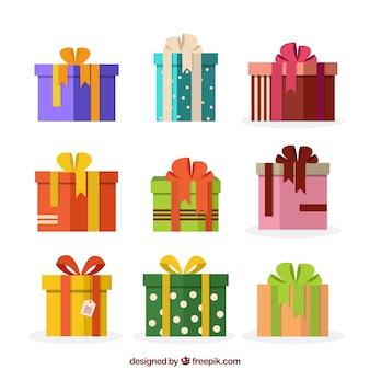Collection décorative de cadeaux de noël dans la conception plate
