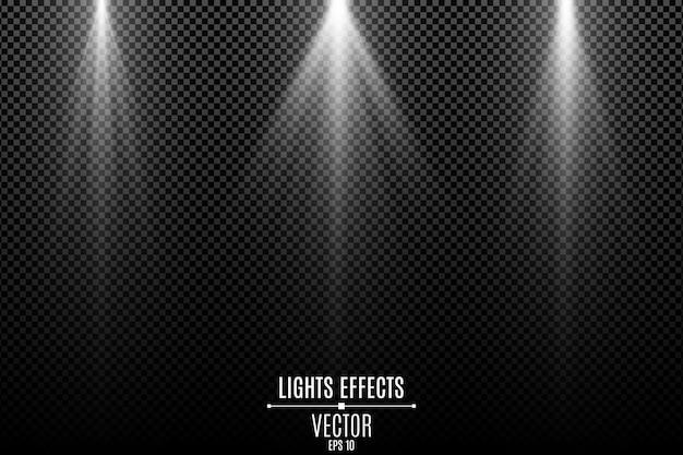 Collection d'effets de lumières blanches isolés sur un fond transparent sombre. rayons blancs élégants.