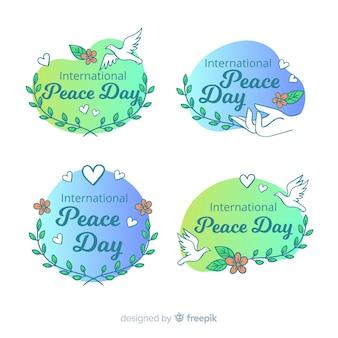 Collection d'étiquettes de jour de la paix dessinés à la main