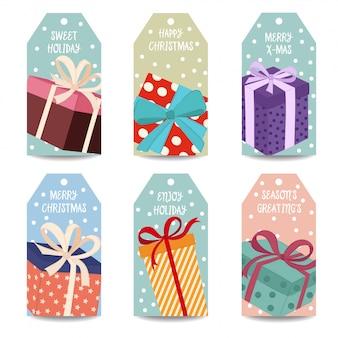 Collection d'étiquettes de noël avec boîtes à cadeaux