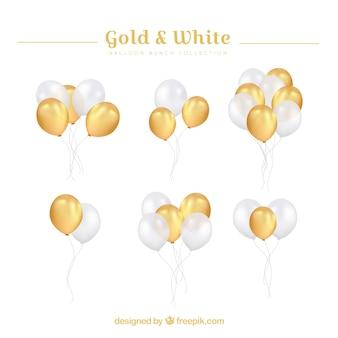 Collection de grappes de ballons or et blancs