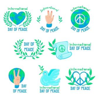 Collection d'insignes de la journée internationale de la paix dessinés à la main