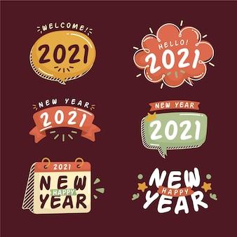 Collection d'insignes de nouvel an 2021 dessinés à la main