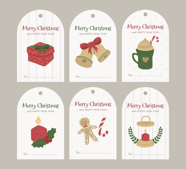 Collection de jeux de cartes de noël aux couleurs chaudes avec des cloches-cadeaux, des bougies à café et des biscuits au pain d'épice