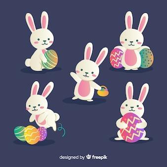 Collection de lapin de pâques dessinés à la main avec des oeufs