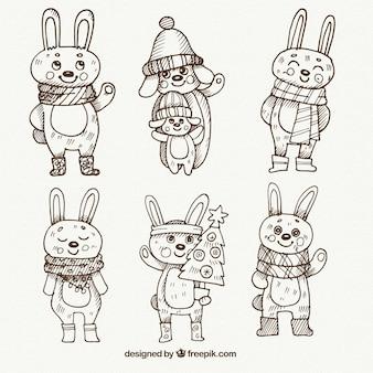 Collection de lapins superbe dessiné à la main avec des vêtements d'hiver