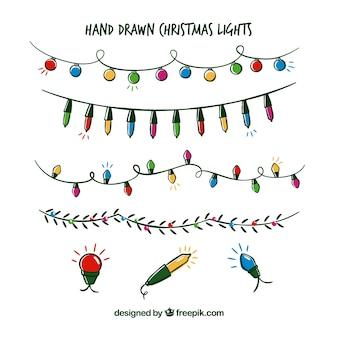 Collection de lumières de noël dessinés à la main