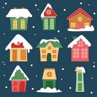 Collection de maisons d'hiver. maison de neige de dessin animé et ensemble de chalets ruraux. bâtiments enneigés au design plat.