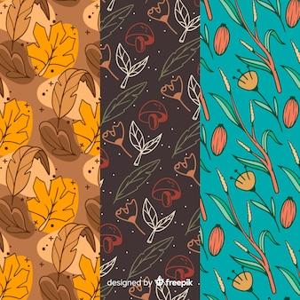 Collection de modèles automne dessinés à la main avec des feuilles