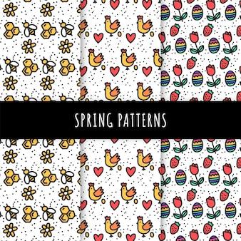 Collection de motifs de printemps dessinés à la main avec des abeilles et des poulets