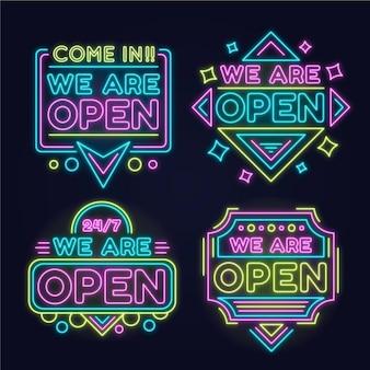 Collection de nous sommes des enseignes au néon ouvertes