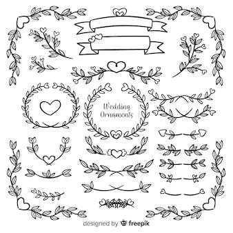 Collection d'ornement de mariage dessinés à la main isolée
