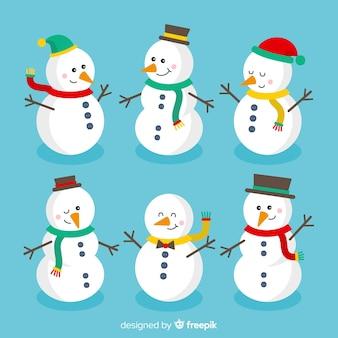 Collection de personnage mignon bonhomme de neige au design plat