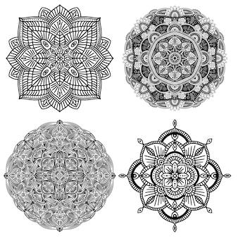 Collection de quatre mandalas ethniques florales noir et blancs, sur fond blanc