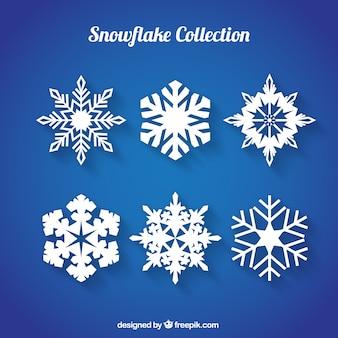 Collection de six flocons de neige avec des dessins fantastiques