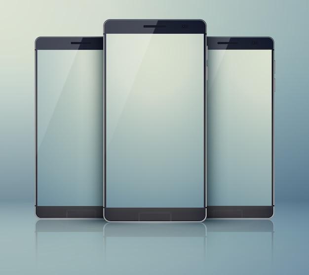 Collection de smartphones en trois pièces sur le gris avec des téléphones portables identiques modernes et avec des ombres sur leurs écrans tactiles numériques légers