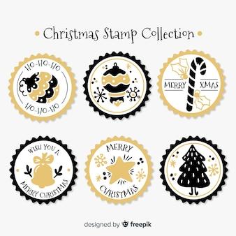 Collection de timbres entourés de détails dorés de noël